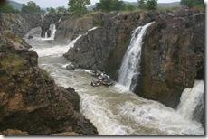 Coracle underneath Hogenakkal waterfall